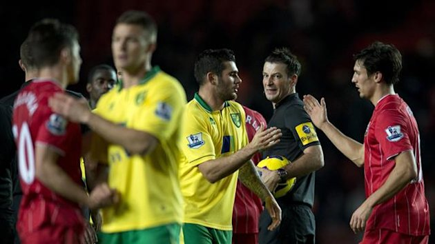 Southampton players react angrily after Mark Clattenburg awards a stoppage-time penalty to Norwich (AFP)