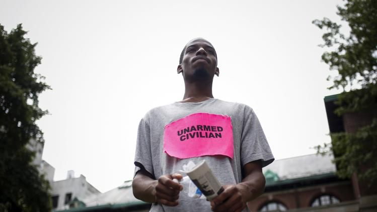"Terell Erskine, 22, stands during the ""We Will Not Go Back"" march and rally for Eric Garner in the Staten Island borough of New York"