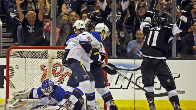 Los Angeles Kings center Anze Kopitar (11), of Yugoslavia, celebrates his game-winning goal against St. Louis Blues goalie Brian Elliott (1) in the third period of Game 4 of the NHL Western Conference Stanley Cup hockey playoff series in Los Angeles, Saturday, May 4, 2013. The Kings won, 4-3. (AP Photo/Reed Saxon)