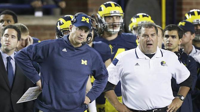 In this Sept. 20, 2014, file photo, Michigan offensive coordinator Doug Nussmeier, left, and head coach Brady Hoke watch from the sidelines during the closing minutes of their 26-10 loss to Utah during the second half of their NCAA college football game in Ann Arbor, Mich. Early Tuesday, Sept. 30, 2014, roughly 12 hours after embattled Michigan coach Brady Hoke said he'd been given no indication that quarterback Shane Morris had been diagnosed with a concussion, athletic director Dave Brandon revealed in a post-midnight statement that the sophomore did appear to have sustained one