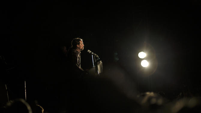 Pablo Iglesias, leader of the Podemos (We Can) party gives a speech in support of local candidate for Ahora Madrid (Madrid Now) party in Madrid, Spain, Sunday, May 24, 2015. Ahora Madrid stood for the Madrid municipal elections to seek an end nearly four decades of dominance by the conservative Popular Party and the center-left Socialists.(AP Photo/Daniel Ochoa de Olza)