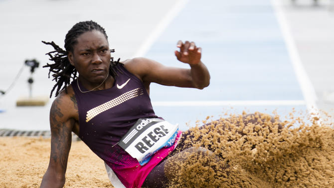 Brittney Reese, of the USA, competes in the Women's Long Jump during the IAAF Diamond League Adidas Grand Prix competition on Randall's Island Saturday, May 25, 2013, in New York. (AP Photo/John Minchillo)