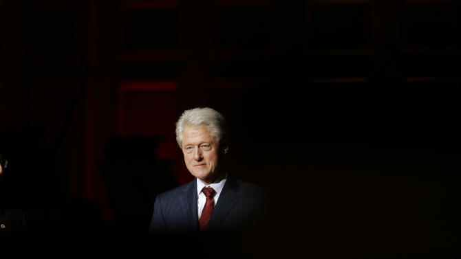 Former President Bill Clinton walks onto the stage at Symphony Hall before accepting a City Year Legacy Award at a Boston Pops Concert Celebrating City Year's 25th Anniversary Thursday, May 22, 2014 in Boston. (AP Photo/Stephan Savoia)
