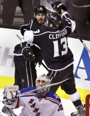 Doughty celebrates his goal on Rangers goalie Henrik Lundqvist with teammate Kyle Clifford during Game 1 of Stanley Cup Final in Los Angeles. (Reuters...