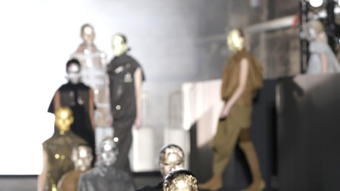 Models wear creations for American designer Rick Owens' fall-winter 2015-2016 ready to wear fashion collection, presented at Paris fashion week, Paris, France, Thursday, March 5, 2015. (AP Photo/Christophe Ena)