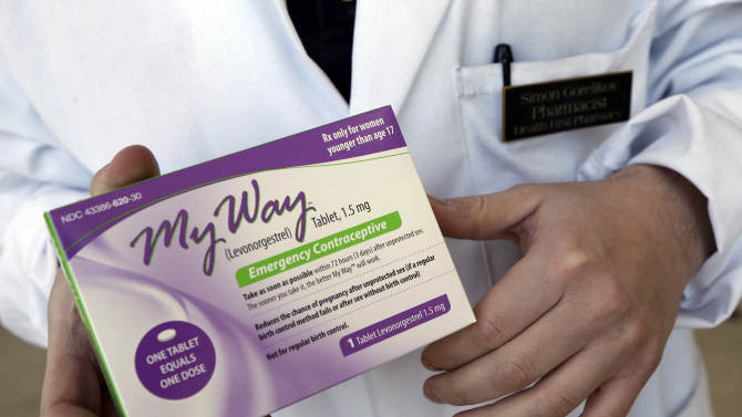 FILE - In this May 2, 2013 photo, pharmacist Simon Gorelikov holds a generic emergency contraceptive, also called the morning-after pill, at the Health First Pharmacy in Boston. A federal appeals court has decided to permit girls of any age to buy generic versions of emergency contraception without prescriptions while the federal government appeals a judge's ruling allowing the sales. The order Wednesday, June 5, 2013 was met with praise from advocates for girls' and women's rights and scorn from social conservatives and other opponents, who argue the drug's availability takes away the rights of parents of girls who could get it without their permission. It is the latest in a series of rulings in a complex back-and-forth over access to the drug. (AP Photo/Elise Amendola, File)