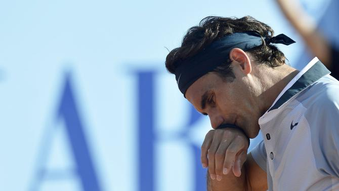 Roger Federer of Switzerland reacts during his match against Daniel Brands of Germany, a second round match at the Suisse Open tennis tournament in Gstaad, Switzerland, Thursday July 25, 2013. (AP Photo/Keystone/Peter Schneider)