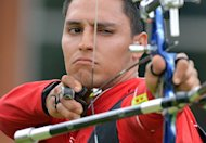 Luis Eduardo Velez of Mexico shoots an arrow during their bronze medal match against South Korea on Day 1 of the London 2012 Olympic Games at Lord's Cricket Ground on July 28, 2012 in London. AFP PHOTO/JEWEL SAMAD