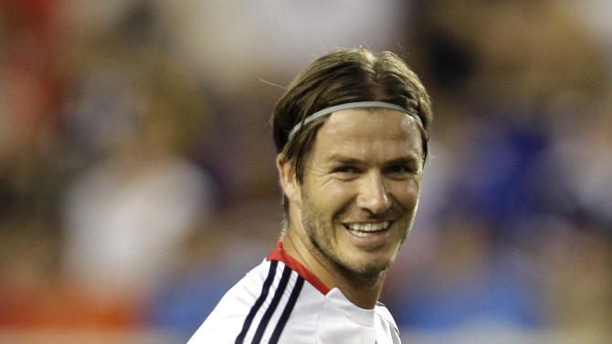 MLS All-Stars' David Beckham, of the Los Angeles Galaxy, smiles before a soccer game between the MLS All-Stars and Manchester United on Wednesday, July 27, 2011, in Harrison, N.Y. (AP Photo/Julio Cortez