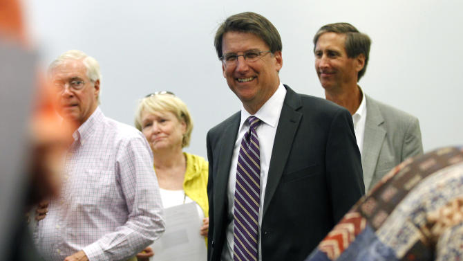 FILE - In this Oct. 23, 2012, file photo, North Carolina Republican gubernatorial candidate Pat McCrory smiles after voting at a polling place in Charlotte, N.C. Republicans are in position to extend their recent gains among governors as they compete for seats they haven't won in a quarter-century. Of the 11 states with gubernatorial elections in November, eight are now led by Democrats, and each of the most competitive races is a GOP pickup opportunity. The numbers suggests that Republicans soon will claim 30 to 33 governorships after holding just 22 a few years ago _ an advantage not reflected in the divided Congress or competitive presidential race. North Carolina, the most likely state to flip, is trending toward a Republican governor for the first time since 1988. (AP Photo/Chuck Burton, File)