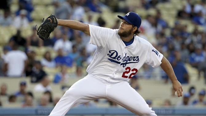 Los Angeles Dodgers starting pitcher Clayton Kershaw throws against the Colorado Rockies during first inning of a baseball game in Los Angeles, Wednesday, June 18, 2014. (AP Photo/Chris Carlson)