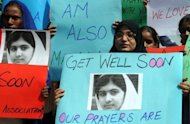 Pakistani students carry placards with the photograph of child activist Malala Yousafzai during a demonstration in Lahore on October 16. The 14-year-old Pakistani girl shot in the head by the Taliban is in a stable condition in a British hospital
