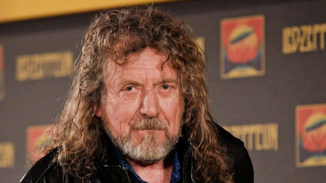 Led Zepplin frontman Robert Plant poses for a photo at a media screening ahead of the worldwide theatrical release of Led Zeppelin's 2007 Celebration Day concert at the O2, Friday, Sept. 21, 2012, in London. (Photo by Miles Willis/Invision/AP)