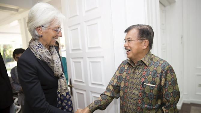 International Monetary Fund Managing Director Lagarde is greeted by Indonesia's Vice President Kalla at the Vice President's Palace in Jakarta