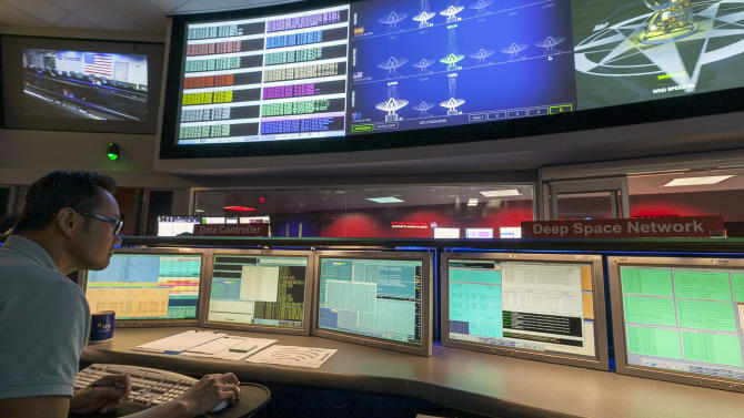 Nick Lam, data controller, monitors the Mars rover Curiosity from the Deep Space Network's control room at NASA's Jet Propulsion Laboratory in Pasadena, Calif., Thursday, August 2, 2012. After traveling 8 1/2 months and 352 million miles, Curiosity will attempt a landing on Mars the night of Aug. 5, 2012. (AP Photo/Damian Dovarganes)