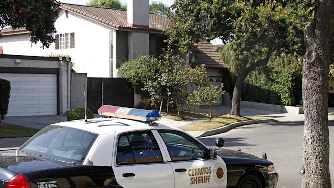 "An unoccupied Los Angeles County Sheriff's Department patrol car is parked across from the home, background, of Nakoula Basseley Nakoula, the man who made the film ""Innocence of Muslims"" that has sparked violent protests, in Cerritos, Calif., Tuesday, Sept. 25, 2012. The filmmaker has received death threats and was forced into hiding, putting his home up for sale, after the 14-minute movie trailer rose to prominence. (AP Photo/Reed Saxon)"