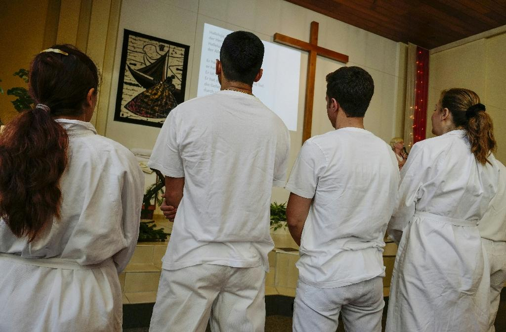 In Germany, some Muslim refugees convert to Christianity
