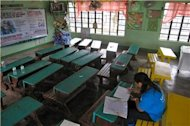 Teachers await children after Typhoon Bopha