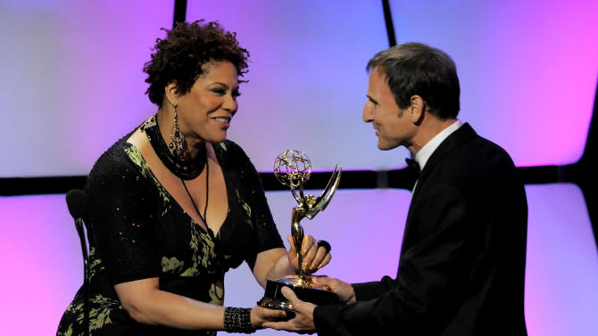 """Kim Coles, left, presents the talk show - entertainment award to Michael Gelman for """"Live with Regis and Kelly"""" onstage at the 39th Annual Daytime Emmy Awards at the Beverly Hilton Hotel on Saturday, June 23, 2012 in Beverly Hills, Calif. (Photo by Chris Pizzello/Invision/AP)"""