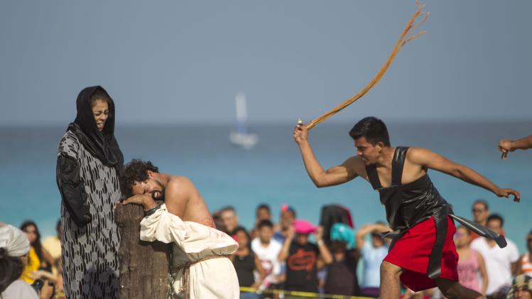 Actors participate in a re-enactment of the crucifixion of Jesus Christ on Good Friday in Cancun