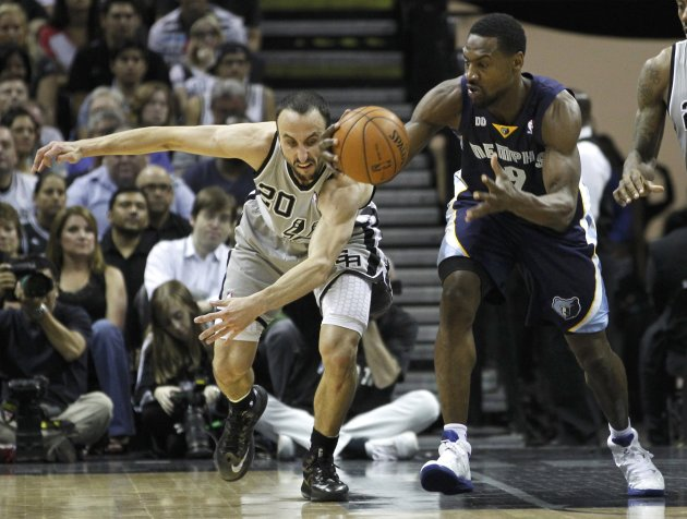 Spurs' Ginobili tries for a steal on Grizzlies' Allen during the second quarter in Game 2 of their NBA Western Conference final playoff basketball series in San Antonio
