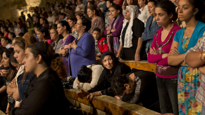 In this Thursday, Nov. 8, 2012 picture, Coptics participate in a mass at the Cave Cathedral or St. Sama'ans Church in the Moqattam area, Cairo, Egypt. Egypt's Christian minority, about 10 percent of the population of more than 80 million, has long complained of discrimination. But Christians fear things are reaching a crisis point since the ouster of President Hosni Mubarak nearly two years ago and the subsequent rise to power of Islamists. The Church itself is undergoing a major transition: A new pope, Tawadros II, is to be enthroned in Cairo on Sunday, succeeding Shenouda III, the man who led the Church for 40 years and was revered by Copts as their protector until his death in March. (AP Photo/Bernat Armangue)