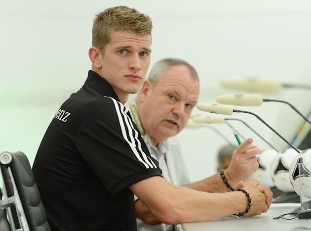 German Midfielder Lars Bender Sits At The Start Of A Press Conference At Media Center Near The Dwor Oliwski Hotel In AFP/Getty Images