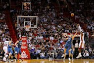 LeBron James of the Miami Heat shoots over Andrei Kirilenko of the Minnesota Timberwolves at American Airlines Arena on December 18, 2012. Miami blew open a close contest with a 17-6 run in the fourth quarter as they beat Minnesota 103-92 behind a 24-point performance from Dwyane Wade. James finished with 22 points and 11 assists for the reigning NBA champion Heat
