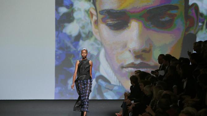 A model wears a creation by fashion designer Raf Simons for Christian Dior's Haute Couture Spring-Summer 2014 collection, presented Monday, July 1, 2013 in Paris. (AP Photo/Francois Mori)