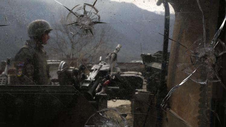 File picture of an Afghan National Army soldier keeping watch at the Forward Base in Nari district in Kunar