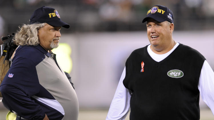 Dallas Cowboys defensive coordinator Rob Ryan, left, chats with his brother, New York Jets head coach Rex Ryan, before an NFL football game on Sunday, Sept. 11, 2011,  in East Rutherford, N.J. (AP Photo/Bill Kostroun)