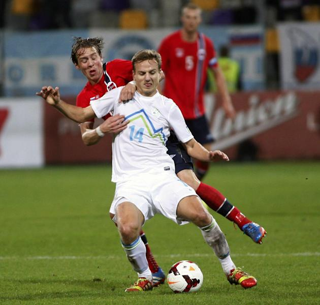 Slovenia's Dejan Lazarevic, front, is challenged by Norway's Stefan Johansen during the 2014 World Cup group E qualifier soccer match between Slovenia and Norway in Maribor, Slovenia, Friday, Oct 11,