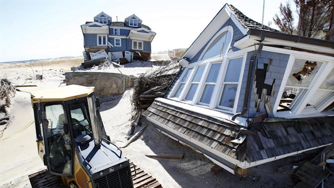 Homes severely damaged last October by Superstorm Sandy, are seen along the beach Thursday, April 25, 2013, in Mantoloking, N.J. Six months after Sandy devastated the Jersey shore and New York City and pounded coastal areas of New England, the region is dealing with a slow and frustrating, yet often hopeful, recovery. (AP Photo/Mel Evans)