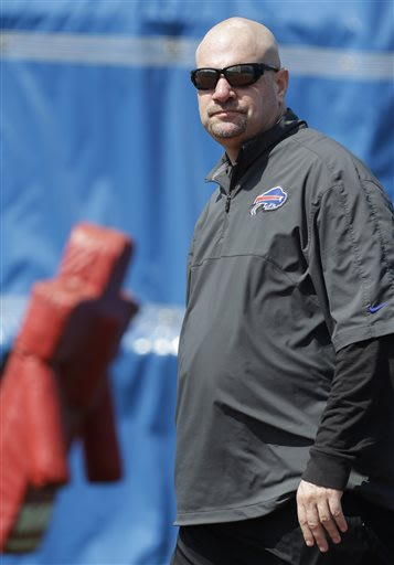 In this May 20, 2013 file photo,  Buffalo Bills new defensive coordinator Mike Pettine looks on during an optional NFL football workout in Orchard Park, N.Y. When it comes to putting together his defe