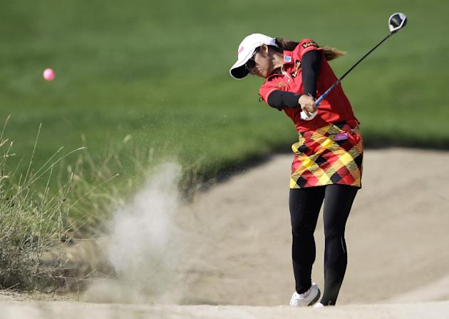 Pornanong Phatlum of Thailand plays a ball on the 10th hole during the final round of the Dubai Ladies Masters golf tournament in Dubai, United Arab Emirates, Saturday, Dec. 7, 2013