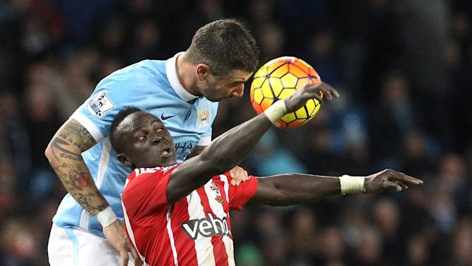 Manchester City's defender Aleksandar Kolarov (L) vies with Southampton's midfielder Sadio Mane during the English Premier League football match in Manchester, England on November 28, 2015