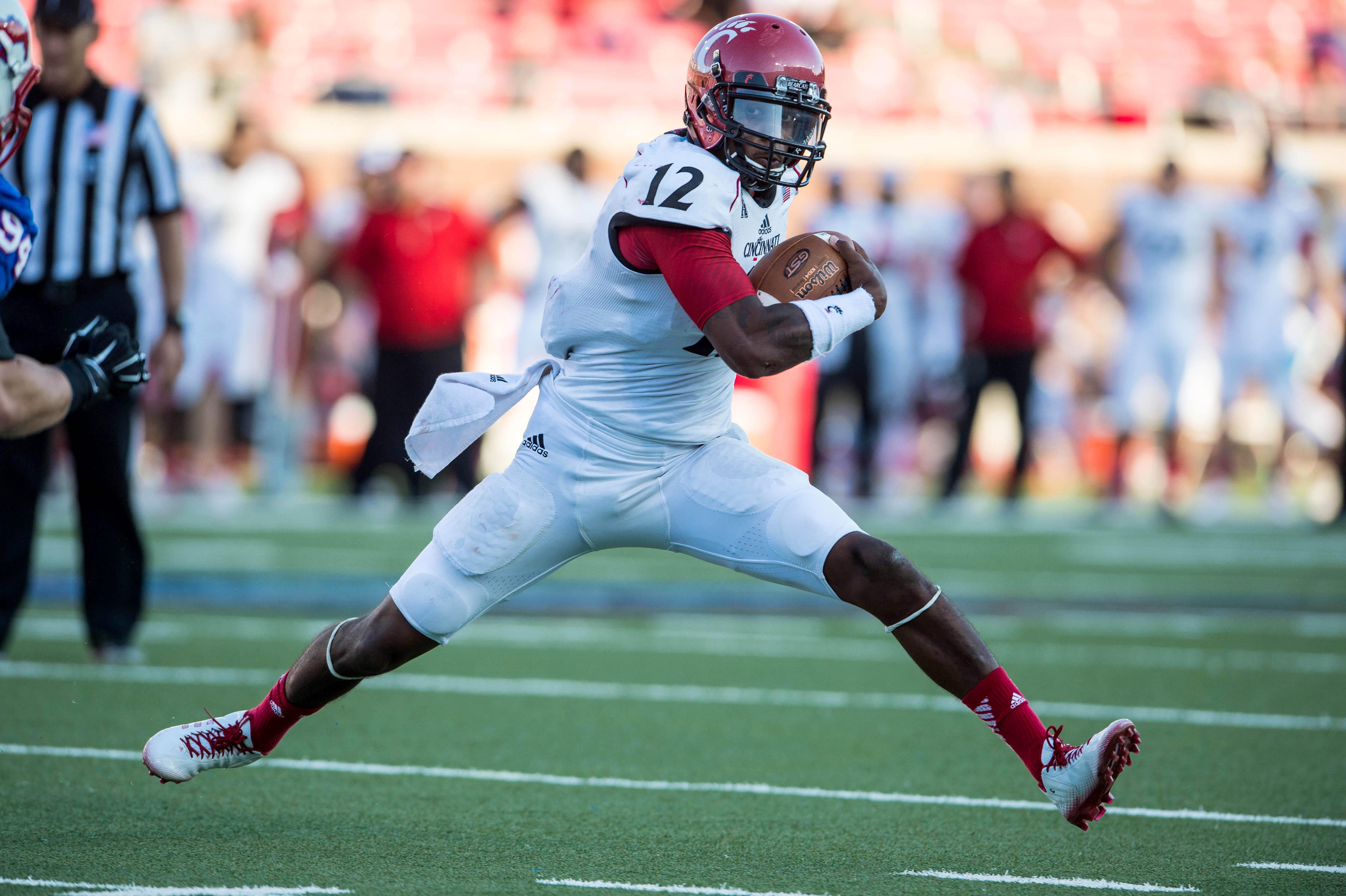 Cincy QB Jarred Evans says racial taunts led to punch