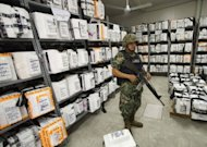 A Mexican marine stands guard inside the Federal Electoral Institute (IFE) building during the counting of votes from the presidential election in Acapulco, Guerrero state, Mexico. Mexico&#39;s national election authority announced a recount of ballots cast at more than half of the polling stations in the country&#39;s weekend presidential election in which Enrique Pena Nieto claimed victory