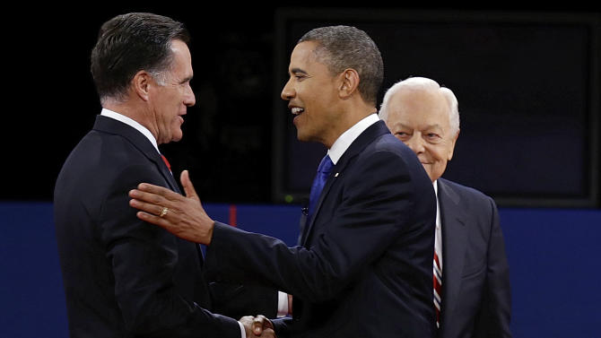 Republican presidential nominee Mitt Romney and President Barack Obama shake hands as moderator Bob Schieffer looks on during the third presidential debate at Lynn University, Monday, Oct. 22, 2012, in Boca Raton, Fla. (AP Photo/Charlie Neibergall)