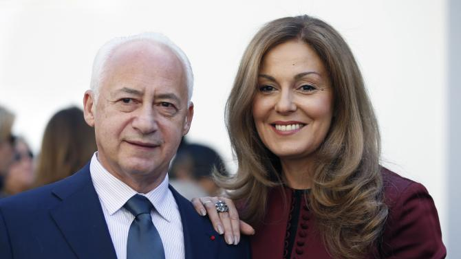 Russian music conductor Vladimir Spivakov and his wife Sati pose before French fashion house Christian Dior Autumn/Winter 2015/2016 women's ready-to-wear collection show during Paris Fashion Week