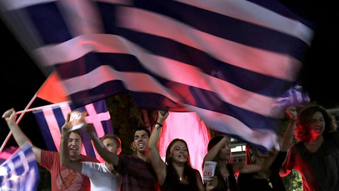 """No"" supporters wave Greek flags by the parliament in Athens"