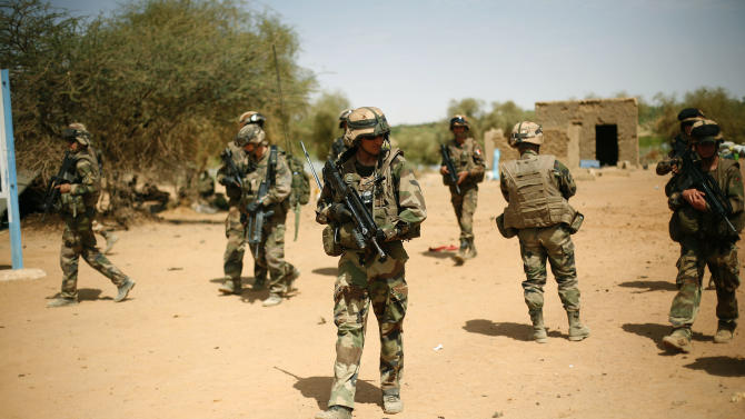 French soldiers secure the area where a suicide bomber attacked, at the entrance of  Gao, northern Mali, Sunday  Feb. 10, 2013. It was the second time a suicide bomber targeted the Malian army checkpoint in three days.  (AP Photo/Jerome Delay)