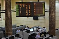 Traders work at the Egyptian stock exchange building in Cairo. President-elect Mohamed Morsi is drawing up a battle plan to confront Egypt's economic and security crises as he pushed ahead with selecting a government of technocrats, a senior aide told AFP