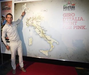 British cyclists Mark Cavendish signs the map during the unveiling of the Giro d'Italia cycling competition, in Milan, Italy, Sunday, Oct. 16, 2011. T