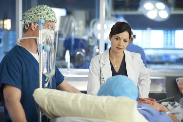 "Erica Durance as Alex Reid in ""Saving Hope."""