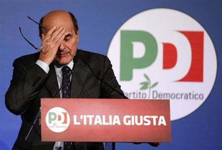 Italian PD (Democratic Party) leader Pier Luigi Bersani reacts during a news conference in Rome February 26, 2013. REUTERS/Tony Gentile