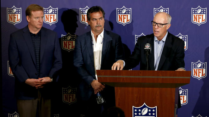 Rich McKay, right, President and CEO of the Atlanta Falcons and co-chairman of the NFL competition committee, speaks on the new rule changes voted on by NFL owners, as NFL Commissioner Roger Goodell, left, and St. Louis Rams head coach Jeff Fisher, the other co-chairman of the NFL competition committee, both listen in at the annual NFL football meetings at the Arizona Biltmore, Wednesday, March 20, 2013, in Phoenix. (AP Photo/Ross D. Franklin)
