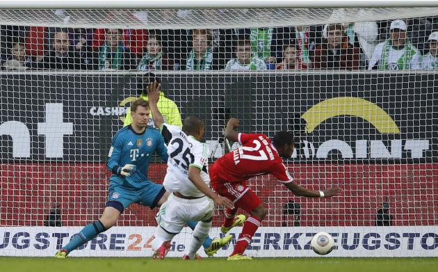 Wolfsburg's Naldo scores a goal against Bayern goalkeeper Neuer and team mate Bayern's Alaba during their German first division Bundesliga soccer match in Wolfsburg