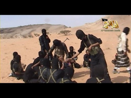 <p>A screen shot of an Internet video from 2010 shows militants from Al-Qaeda in the Arabian Peninsula. A Saudi diplomat abducted by Al-Qaeda in Yemen's south has made a new appeal to King Abdullah to secure his release by meeting the demands of his captors, according to a video posted on jihadist forums.</p>