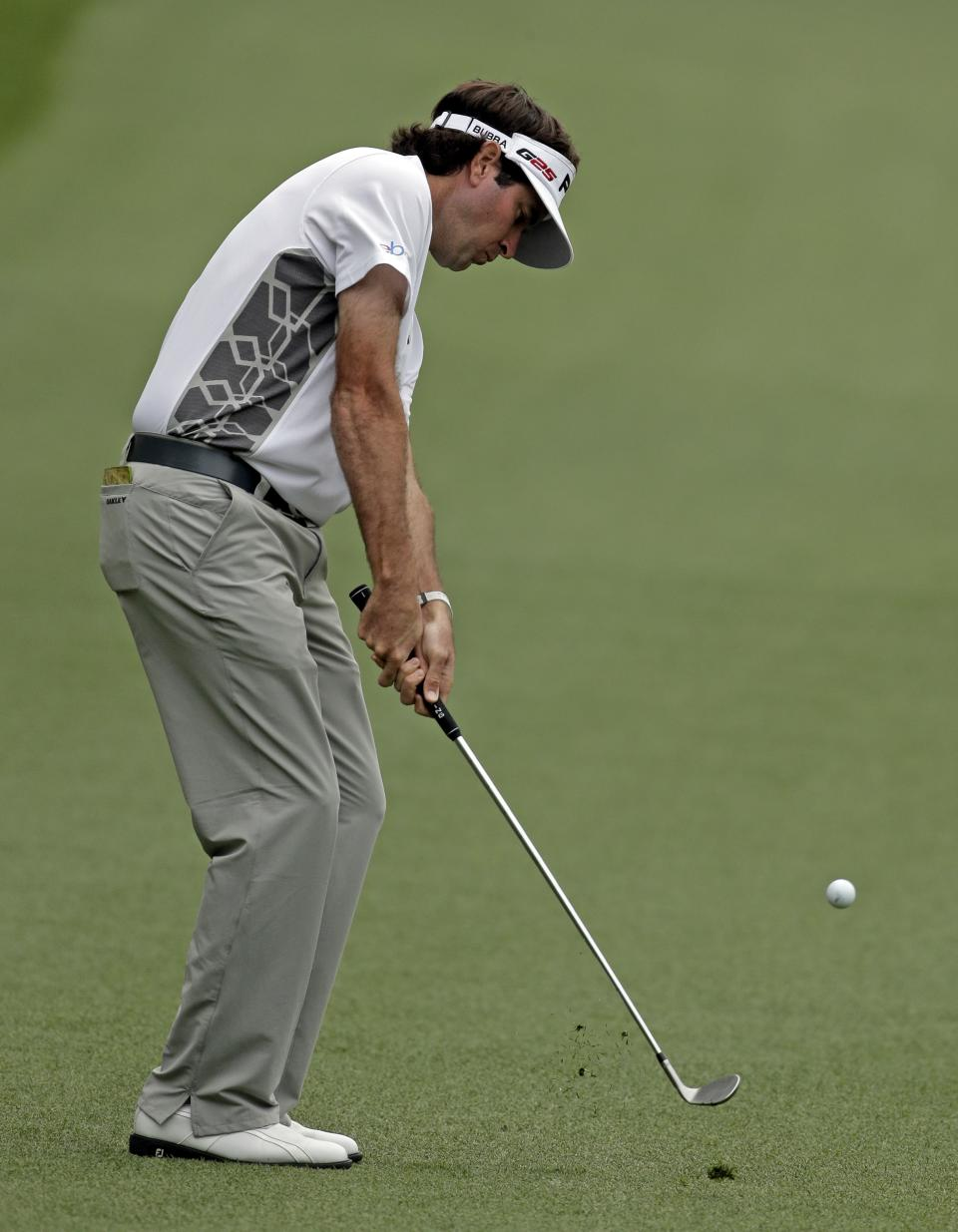 Bubba Watson hits off the first fairway during the fourth round of the Masters golf tournament Sunday, April 14, 2013, in Augusta, Ga. (AP Photo/Charlie Riedel)
